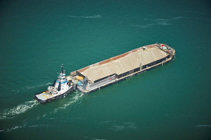 McKeil Marine Limited's tug Leonard M and barge Huron Spirit, transporting 10,000 T of aggregates on Lake Huron.